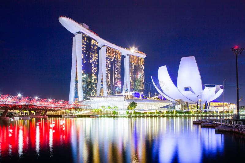 SINGAPORE, SINGAPORE - MARCH 2019: Skyline of Singapore Marina Bay at night with Marina Bay sands and Art Science museum. Reflecting in a pond after rain royalty free stock images