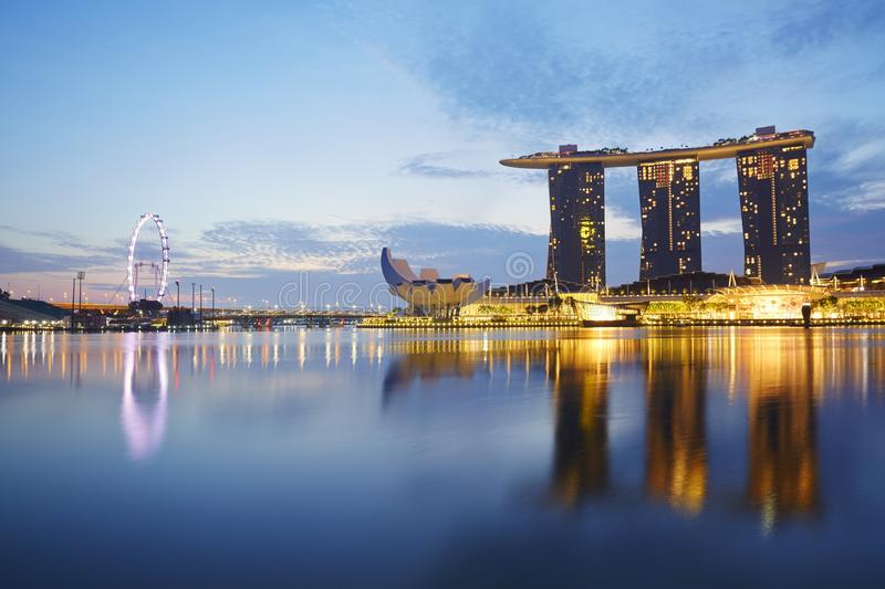 Singapore Marina Bay Sands and Flyer, hotel and resort. Marina Bay Sands and Singapore Flyer the giant ferris wheel at dawn, landmark and modern building in royalty free stock photo