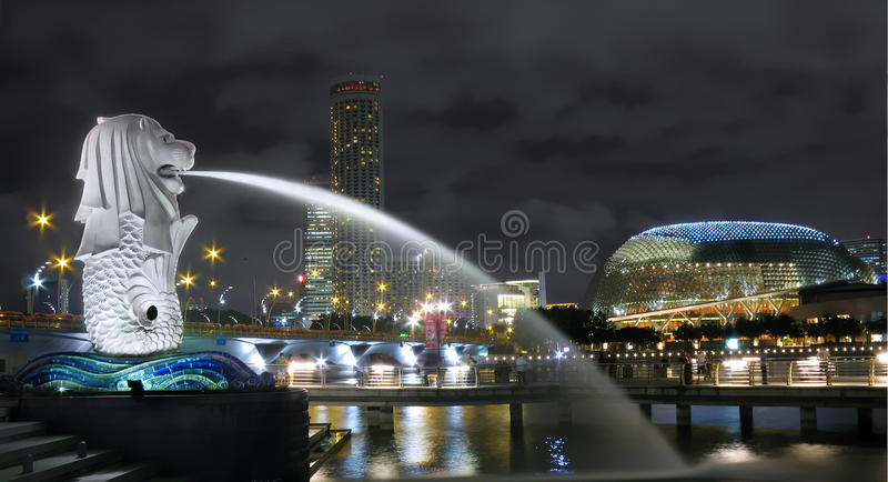 Singapore Merlion Cityscape. Night cityscape in Singapore at Marina Bay. In the foreground is the country's tourism icon, the Merlion. In the background is the royalty free stock photo