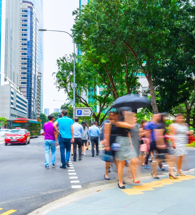 Singapore metropolis downtown crowded street. Crowded street of Singapore business district with corporate buildings and traffic on road royalty free stock images