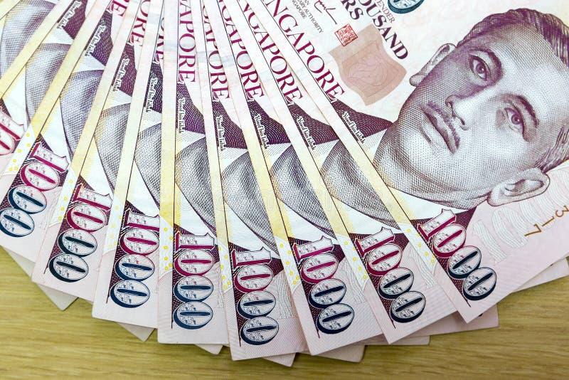 Singapore mille dollari di note di valuta smazzate fuori fotografia stock libera da diritti