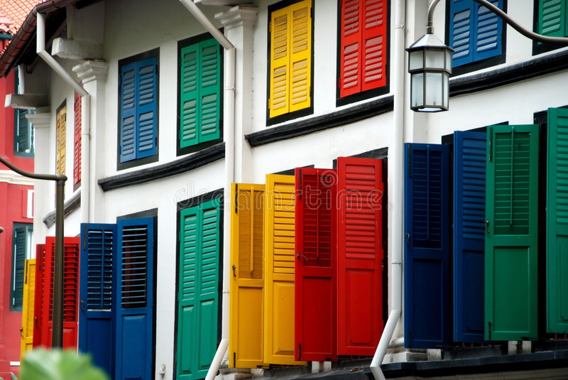 Singapore: Multi-coloured Shutters in Chinatown. A splendidly restored former Chinese shop house on Amoy Street in Singapore's Chinatown with its multi-coloured stock image