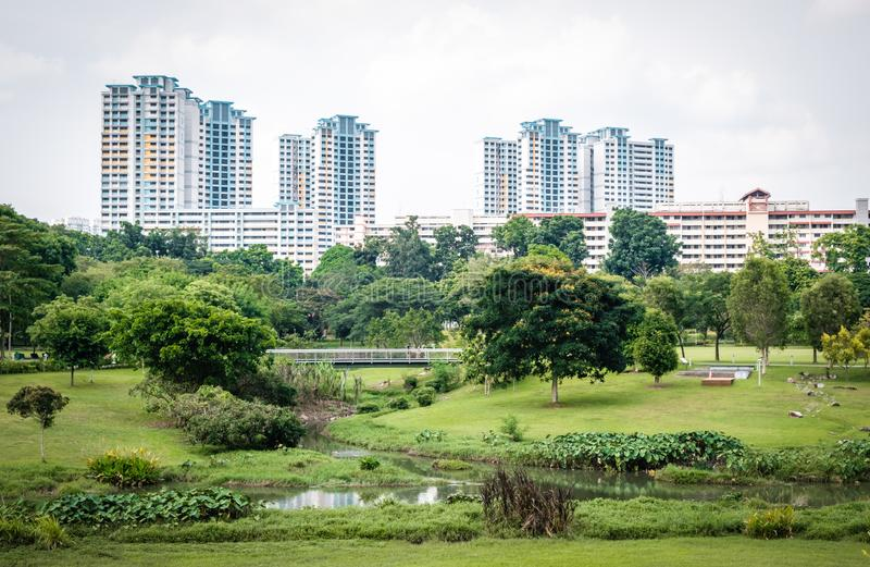 Singapore neighborhood park day view, surrounding the park is residential building stock photography