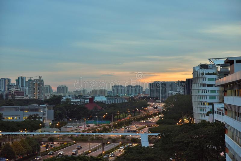 Singapore nightscene. Overlooking a highway from an industrial office stock photography