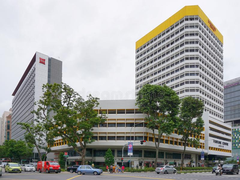 Commercials building on the corner in the Singapore city. SINGAPORE - 27 NOV 2017: Commercials building on the corner in the Singapore city stock images