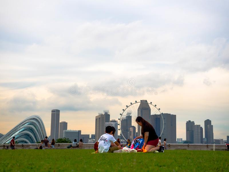SINGAPORE - NOV 25, 2018: Many People enjoying and playing at Marina Barrage. Marina Barrage is a place of recreation, proving royalty free stock photo