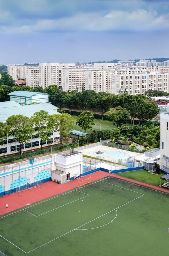 Singapore-26 NOV 2017:Singapore public football field in public housing area stock images