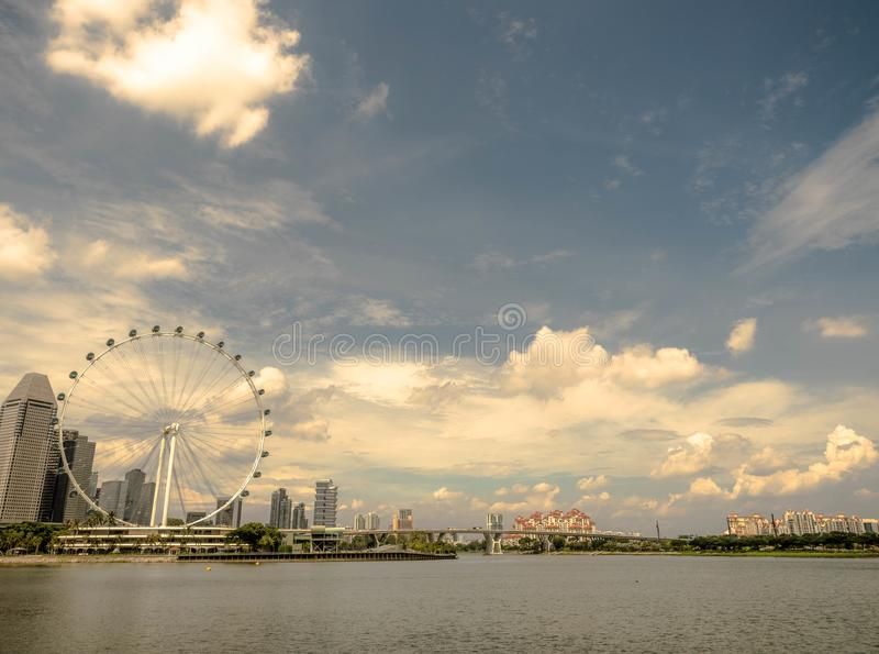 Singapore - NOV 24, 2018 : View of Singapore flyer, Big ferris wheel in the modern city skyline and bay water on front, Singapore.  stock images
