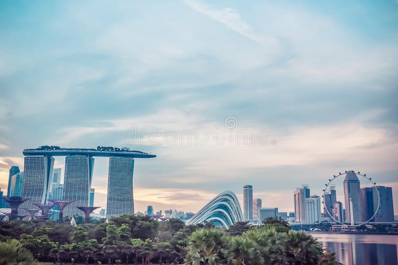 View of the Marina Bay Sands Resort and Gardens by the Bay along Singapore River on sunset. royalty free stock photography