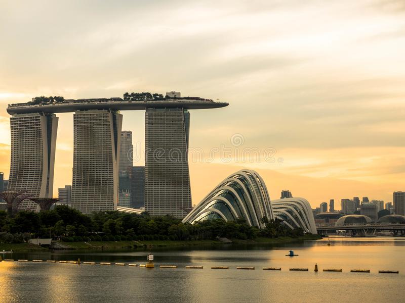 SINGAPORE - NOV 25, 2018 : View of the Marina Bay Sands Resort and Gardens by the Bay along Singapore River on sunset. This stock photo