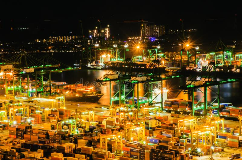 Aerial view of busiest cargo port with hundreds of ships loading export and import goods and thousands of containers in harbr. Singapore. November 26, 2018 stock photos