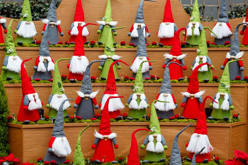 SINGAPORE-November 25, 2019: Group of multi-colored Santa Claus, Christmas decoration in Flower Dome, Gardens by the Bay royalty free stock photo