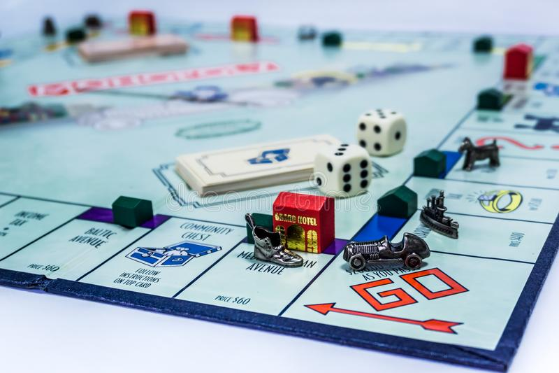 Monopoly Board Game - Wide Angle View. Singapore - November 7, 2017: Monopoly Board Game with the car passing the GO. The classic real estate trading game from stock photo
