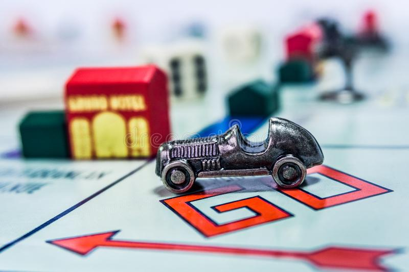 Monopoly Board Game - close up view. Singapore - November 7, 2017: Monopoly Board Game close up with the car passing the GO. The classic real estate trading game stock images