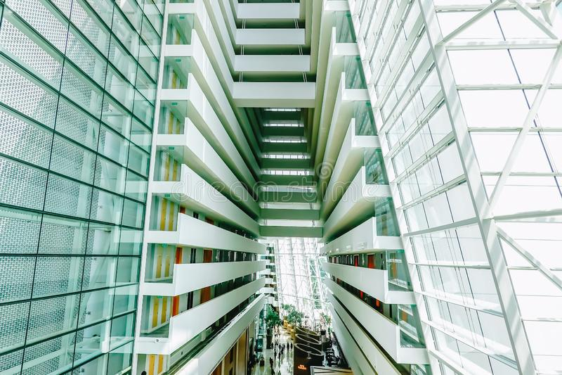 View inside of the abstract modern architecture of the interior of Marina Bay Sands Hotel, one of the most luxurious hotels royalty free stock photos