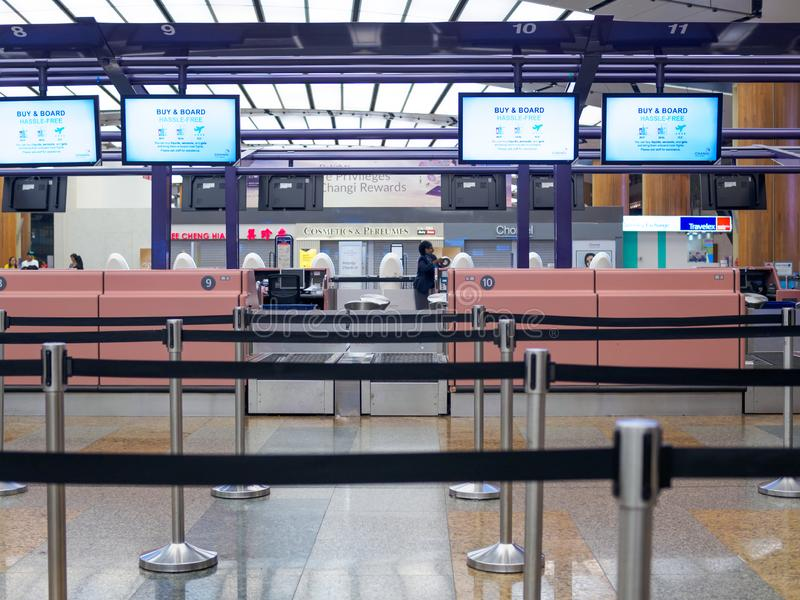 SINGAPORE - 4 OCT 2019 – Frontal view of empty check-in counters at Singapore Changi Airport Terminal 1 Departure Hall royalty free stock images