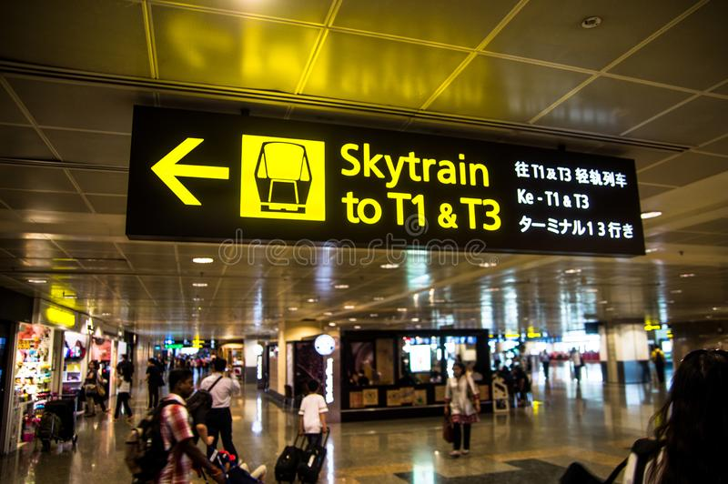 SINGAPORE - 08 OCT, 2013: Navigation signs of skytrain at Terminal 2 of the Changi International Airport in Singapore. stock photo