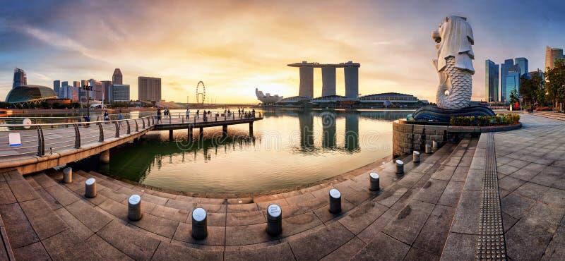 SINGAPORE - OCTOBER 11 2019: Merlion fountain and marina bay sands panorama is famous landmark at sunrise of Singapore city royalty free stock photo