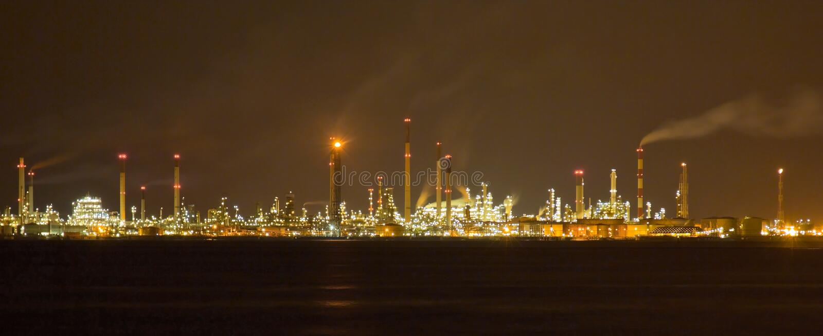 Singapore Oil Refinery and Manufacturing Plants. Nightscape of the oil refinery and chemical manufacturing plants located on Pulau Bukom, Singapore. It is stock photo