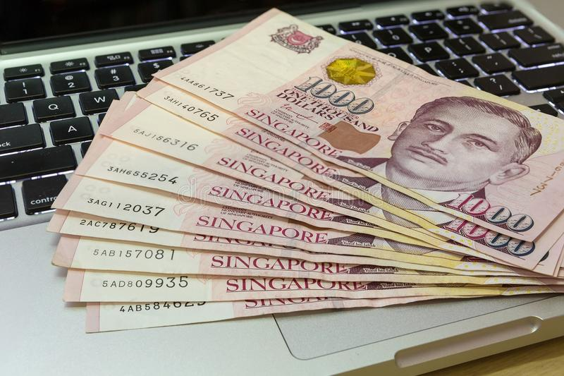 Singapore One Thousand Dollars Currency Notes on Computer royalty free stock photography