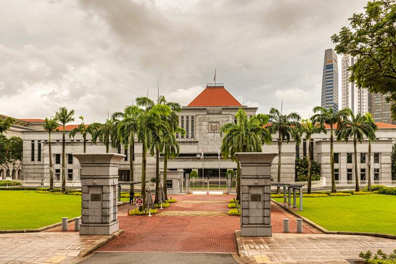 Singapore Parliament building and Downtown Core skyscrapers at t. Singapore - Jan 11, 2018: Entrance gates to Singapore Parliament building and Downtown Core stock photos