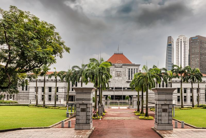 Singapore Parliament building and Downtown Core skyscrapers at t. Singapore - Jan 11, 2018: Entrance gates to Singapore Parliament building and Downtown Core royalty free stock photography