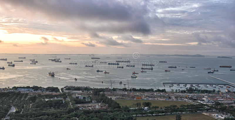 Singapore Port. Ships approaching to dock at Singapore port. View from top of marina bay sand resort hotel royalty free stock photography