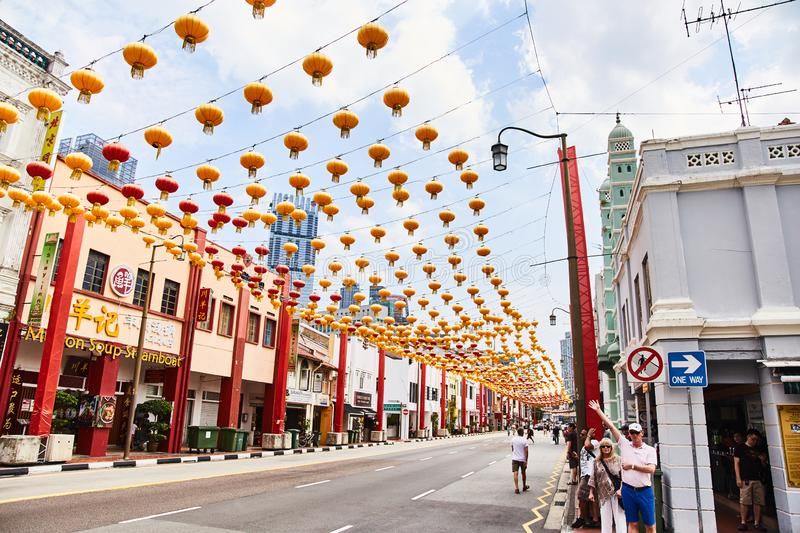 19.03.2019 Singapore: Rows of Chinese red lanterns against blue sky. stock images