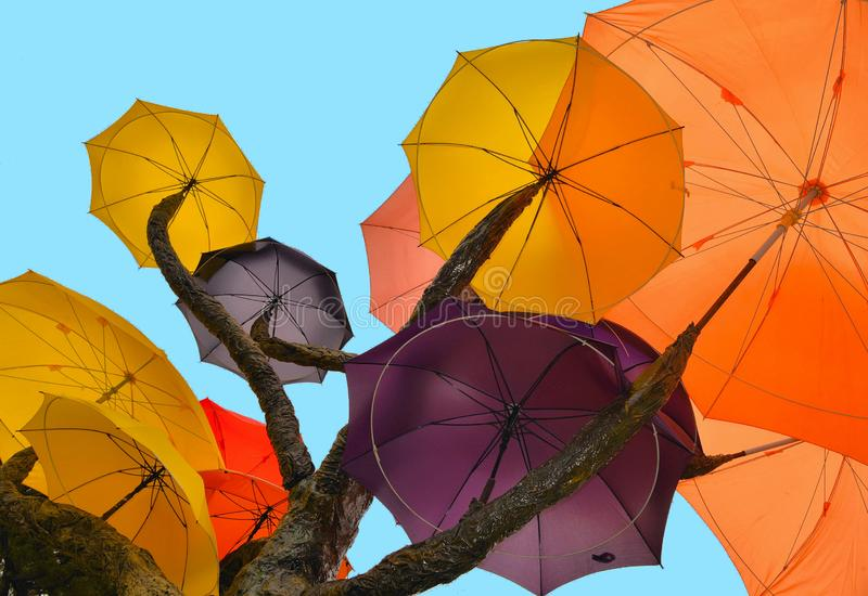 SINGAPORE - Sculpture of tree with colorful umbrellas against blue sky in public park on South Bridge Road near t royalty free stock photo
