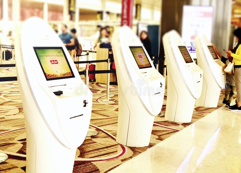 Singapore - self check- in counters at changi airport in terminal 4 royalty free stock photos