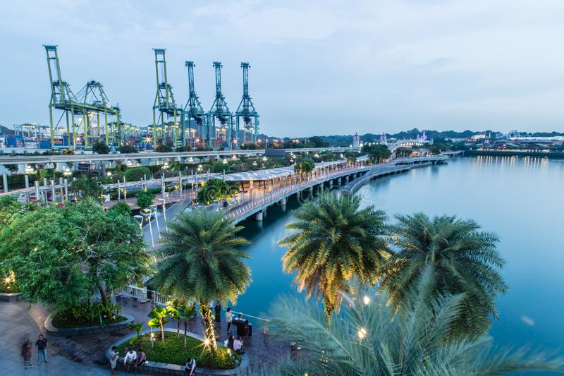Singapore -26 SEP 2017:Singapore harbor machine with reflection night view royalty free stock photos