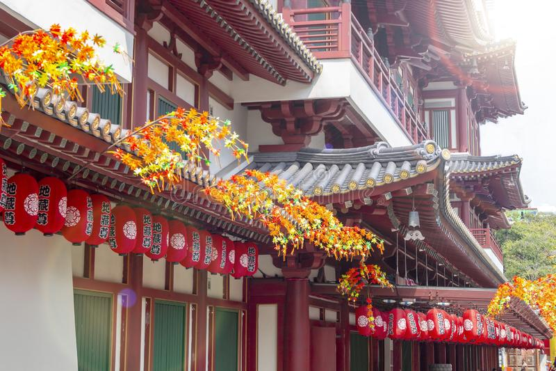 Singapore 1 September 2019 : The famous Buddha Tooth Relic Temple in Chinatown decorated with red lanterns and plants . royalty free stock photo