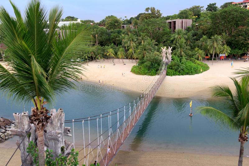 Singapore - SEPTEMBER 30, 2016: Long bridge at sentosa beach. Long bridge at sentosa beach bridge sand trees long ocean stock photos