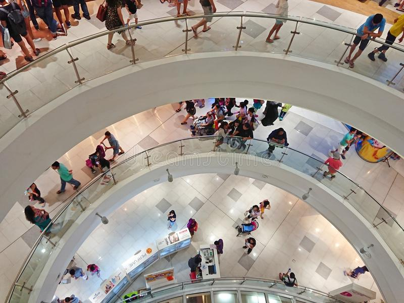 Singapore: Shopping mall. People shopping at multi level shopping mall royalty free stock images