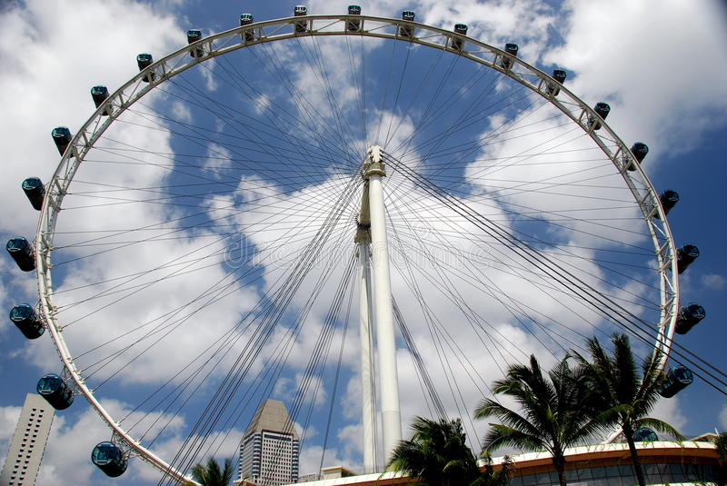Singapore: Singapore Flyer Ferris Wheel. The impressive Singapore Flyer Ferris wheel stands forty stories high with its 28 blue and silver gondolas - Xu Lei royalty free stock image