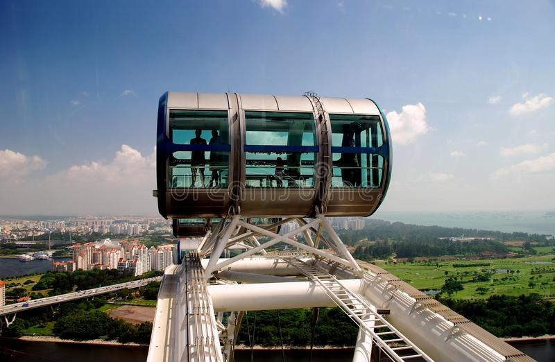 Singapore: Singapore Flyer Ferris Wheel. Singapore: Passengers riding in one of the gondolas high atop the enormous Singapore Flyer ferris wheel view a vast royalty free stock images