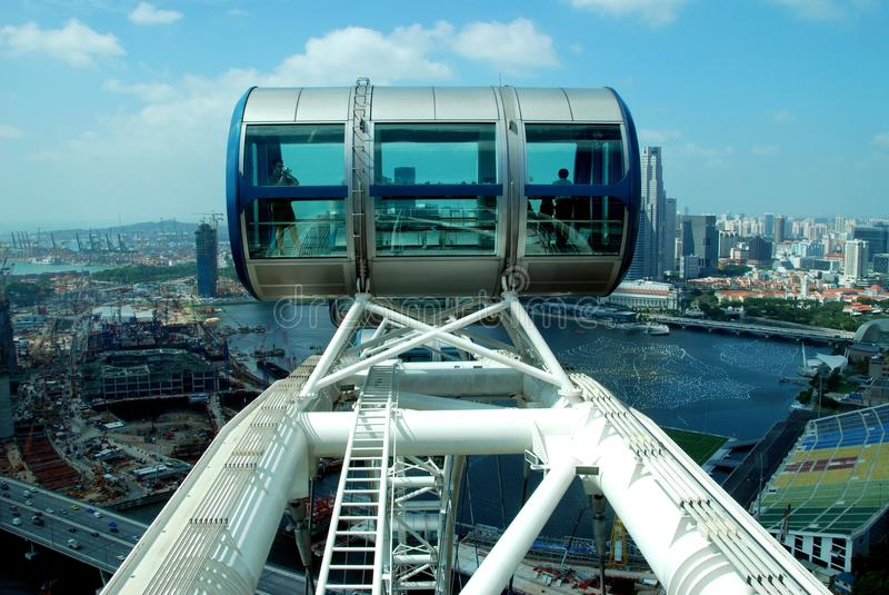 Singapore: Singapore Flyer Gondola. High atop the 541 foot high Singapore Flyer ferris wheel a passenger capsule offers a fantastic panorama of Singapore city royalty free stock image
