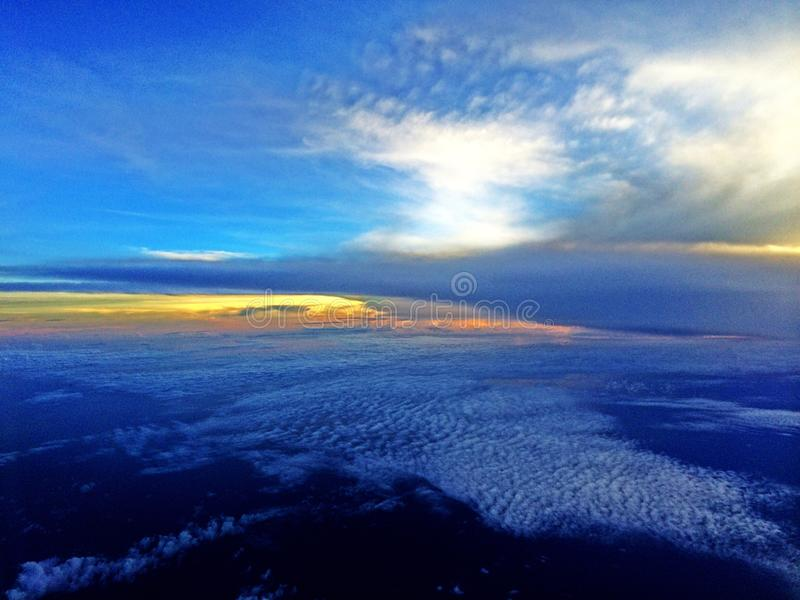 Singapore sky from flight royalty free stock photography