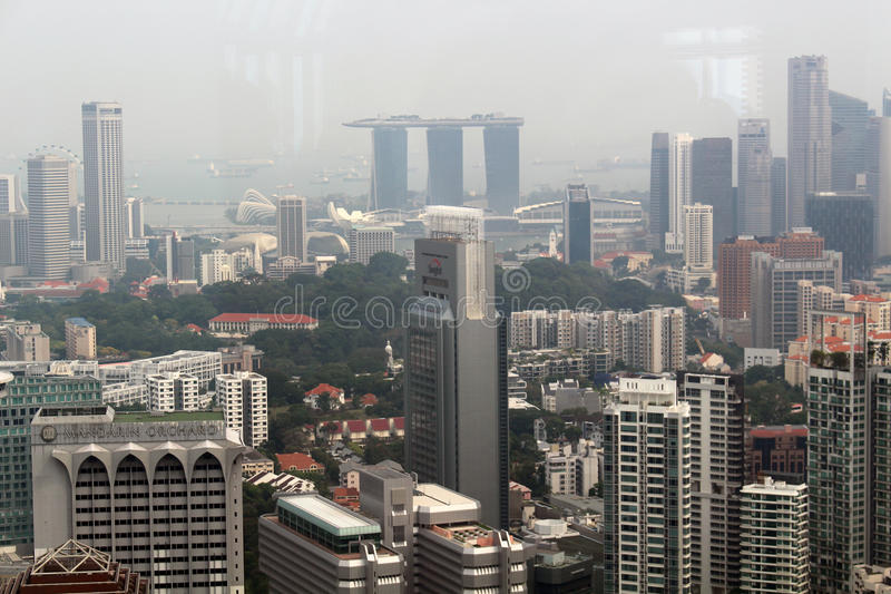 Singapore Skyline. SINGAPORE/SINGAPORE - CIRCA NOVEMBER 2015: View of the Singapore skyscrapers and the Marina Bay Sands hotel from the top of the ION Sky stock photography