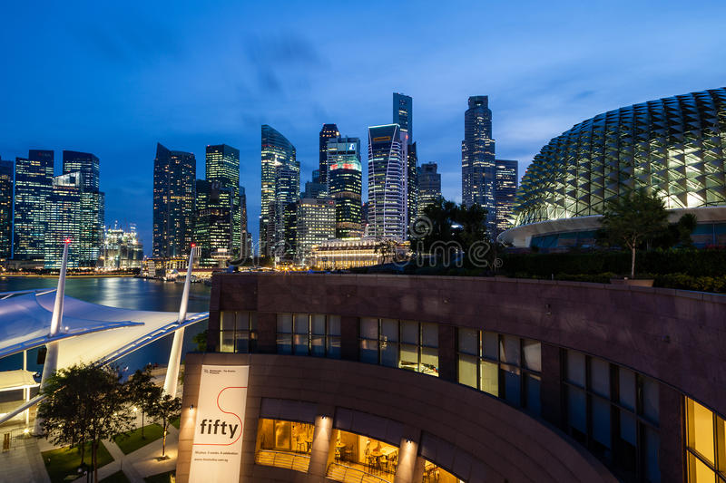 Singapore Skyline at Dusk on the Esplanade. Blue hour at the Esplanade Theater along Marina Bay with the Singapore skyline in the background. The building stock photography