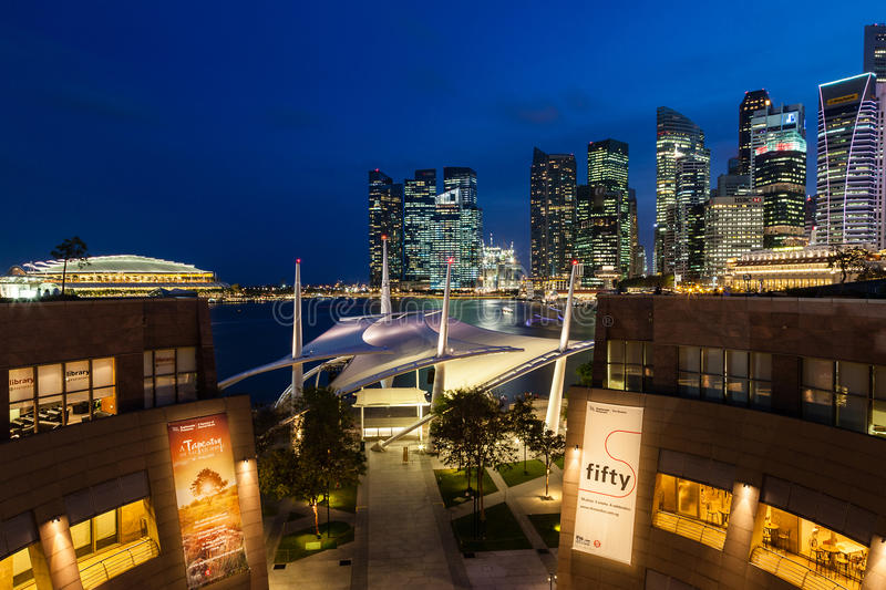 Singapore Skyline at Dusk on the Esplanade. Blue hour at the Esplanade Theater along Marina Bay with the Singapore skyline in the background. The building royalty free stock images