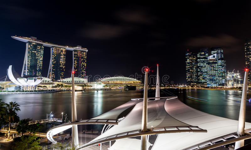 Singapore Skyline at Dusk on the Esplanade. Night scene of the unique Esplanade Outdoor Theater rooftop along Marina Bay with the Singapore skyline in the royalty free stock photos