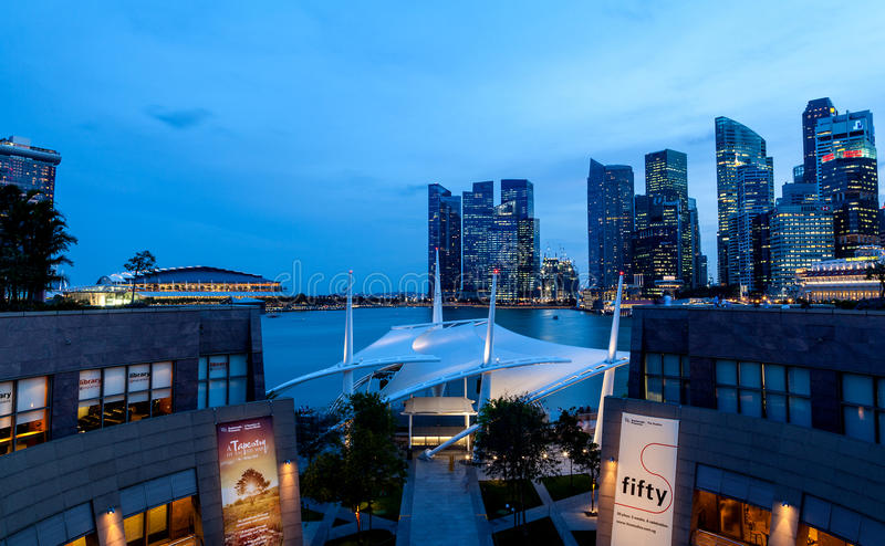 Singapore Skyline at Dusk on the Esplanade. The 450-seat outdoor theatre at the Esplanade along Marina Bay with the Singapore skyline in the background stock photo