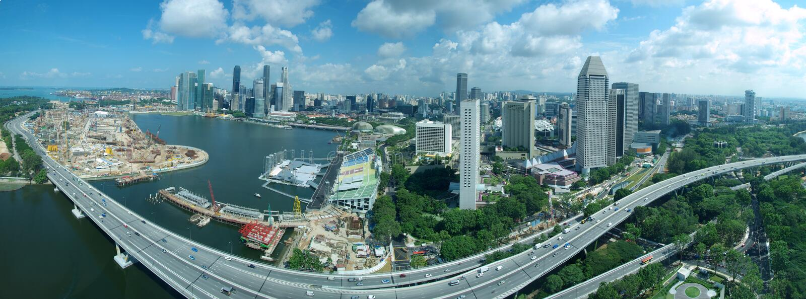Singapore Skyline & Freeway. A panorama of the Singapore city skyline and the freeway snaking around Marina Bay. This aerial view was taken from the Singapore stock photos