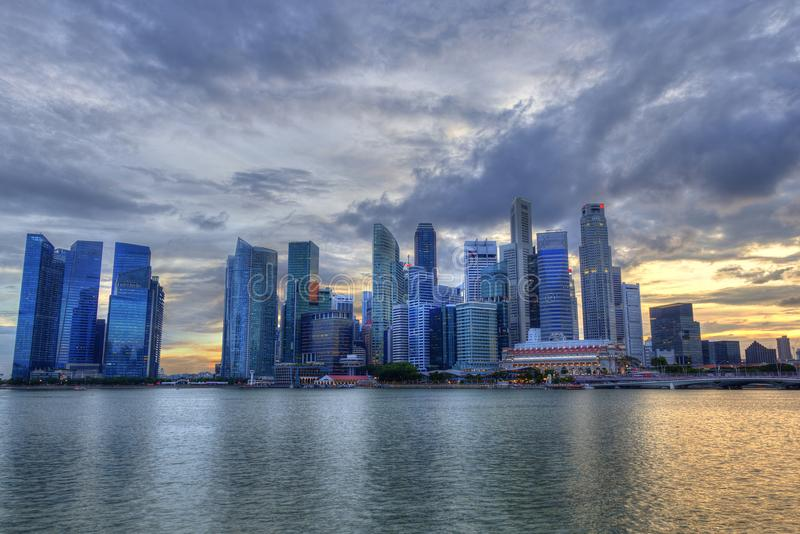 Singapore Skyline at Marina Bay During Sunset. Blue hour showing skyscrapers in downtown central financial business district stock photos