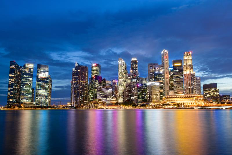 Singapore Skyline at Marina Bay During Sunset Blue Hour. Showing skyscrapers in downtown central financial business district stock images