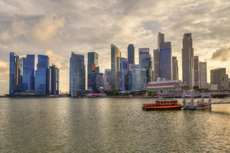 Singapore Skyline at Marina Bay During Sunset. Singapore skyline at Marina Bay during golden sunset showing skyscrapers in downtown central financial business stock photos