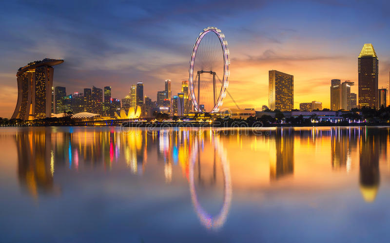 Singapore Skyline. Singapore `s business district. Singapore Skyline. Singapore`s business district, marina bay sand and the garden by the bay on sunset royalty free stock photo