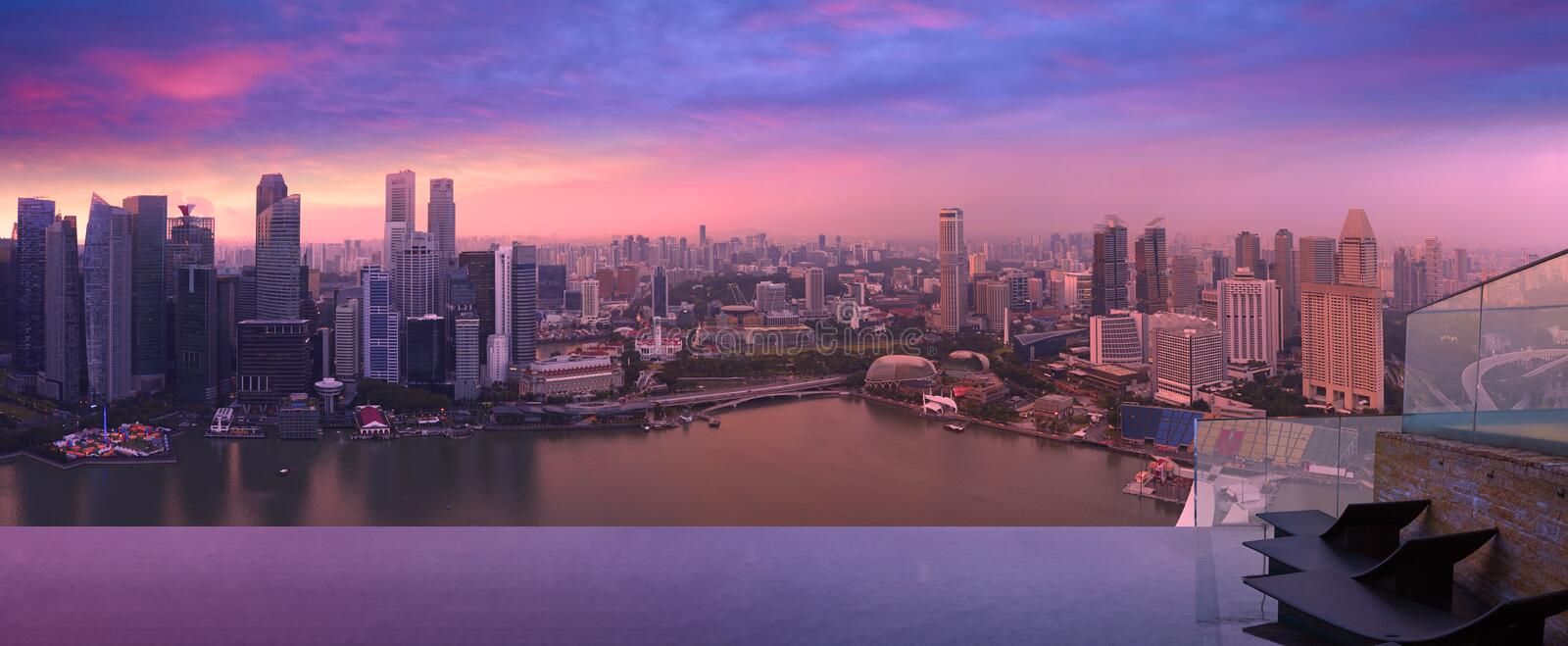 Singapore skyline from Sky pool, violet dust. Panoramic view of Singapore cityscape of central business district with purple evening sky, Sky Park of Hotel royalty free stock photos