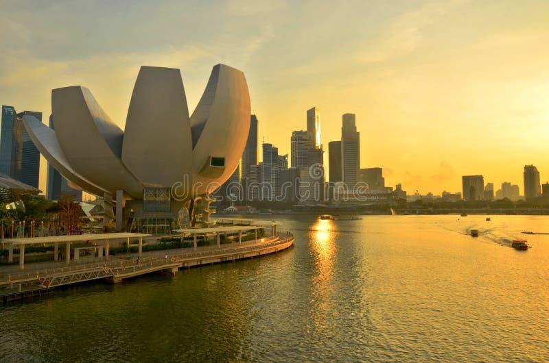 Singapore Skyline Sunset. Art Science Museum with Singapore CBD buildings glowing at sunset stock image